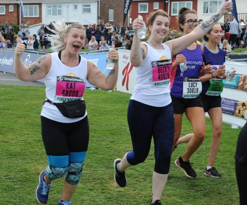 Kat and Becky crossing the finishing line